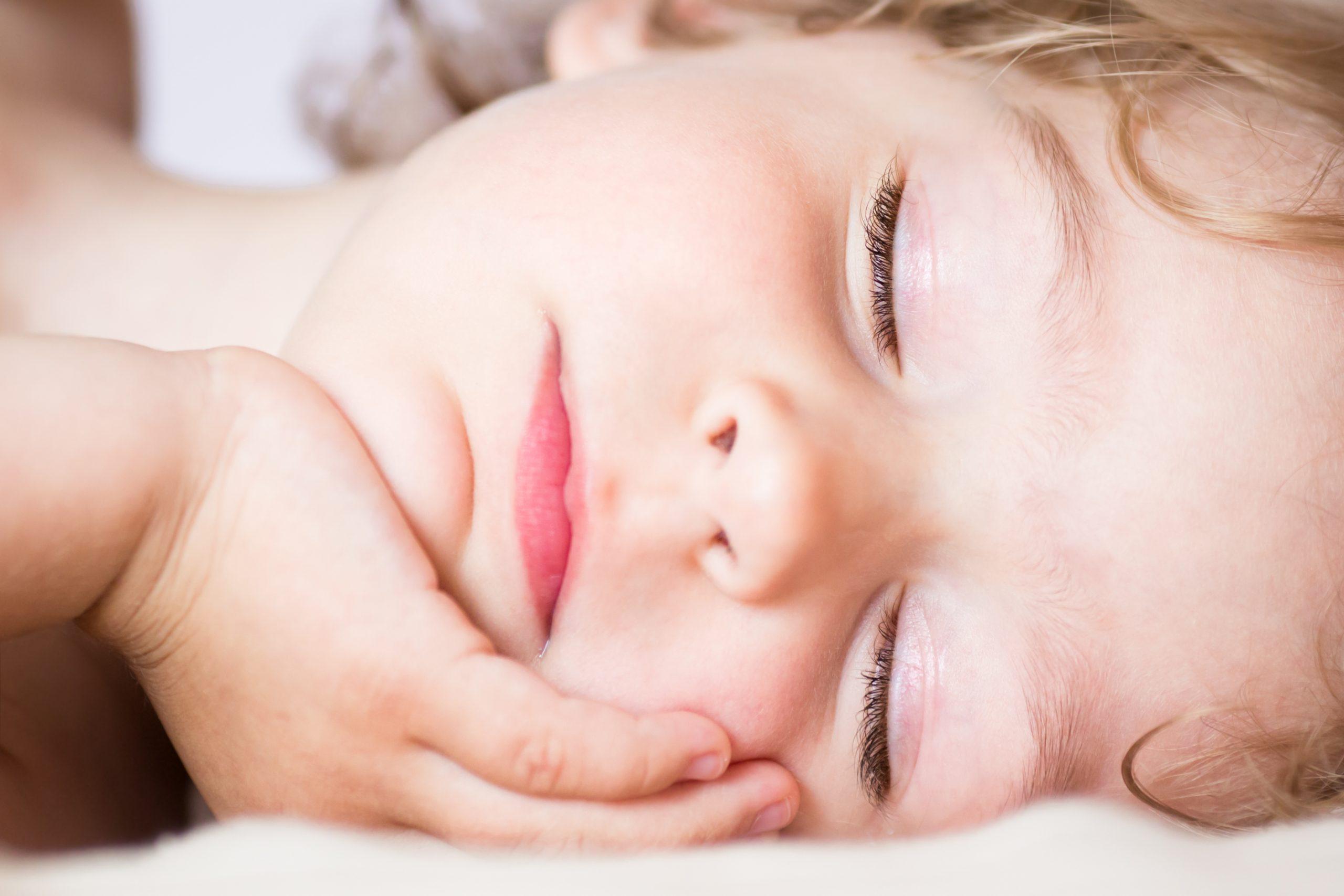 Portrait of the sleeping beautiful baby girl